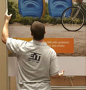 Photo of staff member finishing the installation of a trade show booth